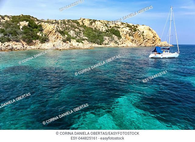 Blue clear waters at Petra Ruja Cove, Sardinia, Italy