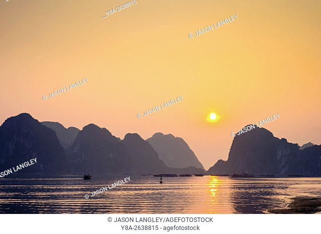 Sunset over karst mountains in Ha Long Bay, Quang Ninh Province, Vietnam