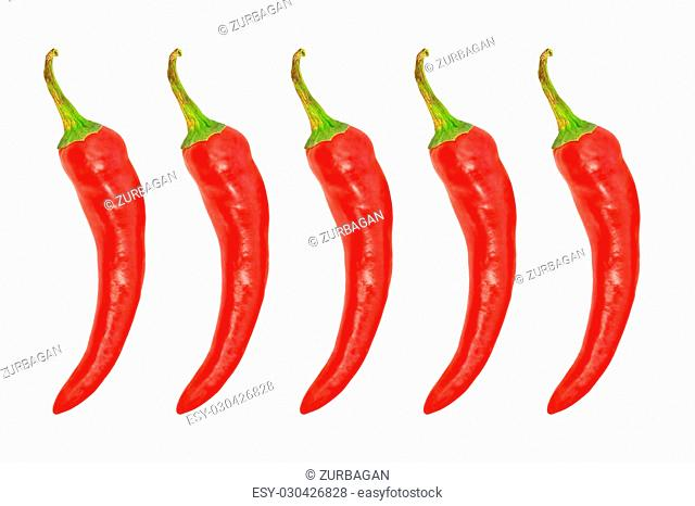 Five red hot chile pepper isolated on a white background