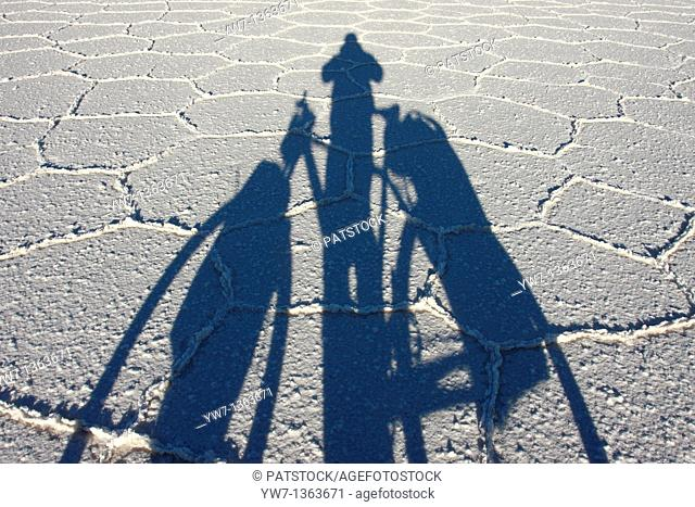 Shadow of a biker on the frozen salt lake called 'Salar de Uyuni' in Bolivia