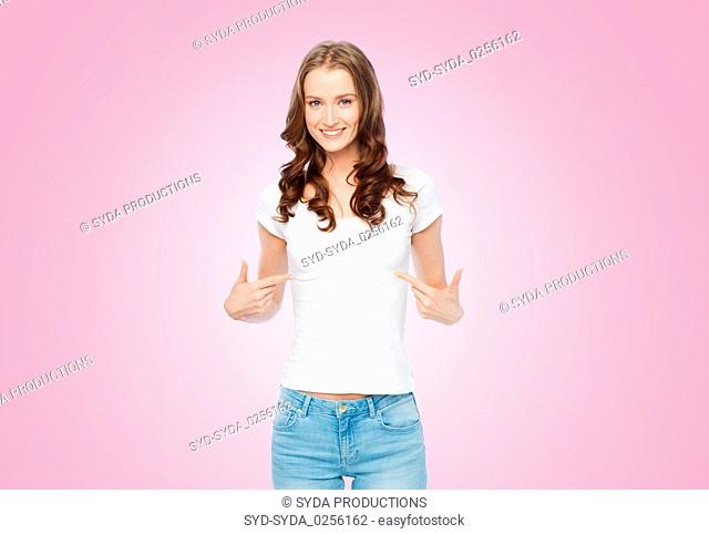 woman in white t-shirt pointing fingers to herself