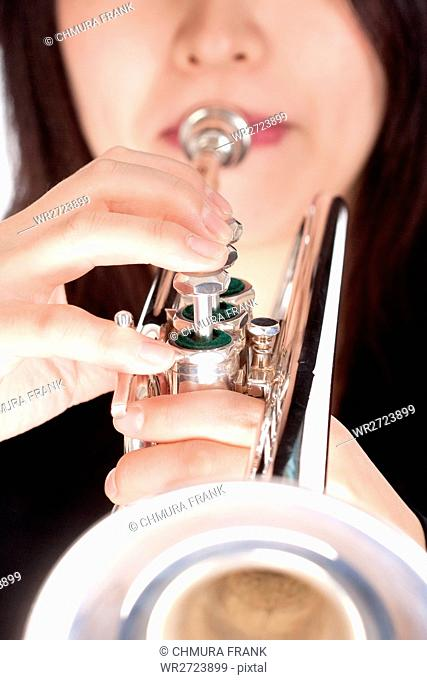 Closeup of Trumpet Player Playing - Isolated on White