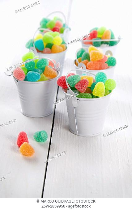 Presentation of small comets full of soft multicolored candies
