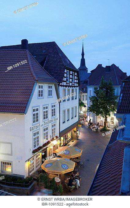 Restaurant near Heger Gate at dusk, historic town centre, Osnabrueck, Lower Saxony, Germany, Europe