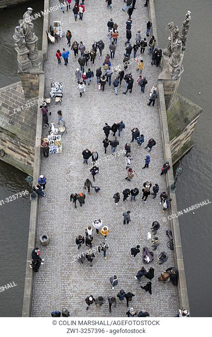 Overhead view of people passing musicians on bridge from Old Town Bridge Tower, Charles Bridge, Prague, Czech Republic