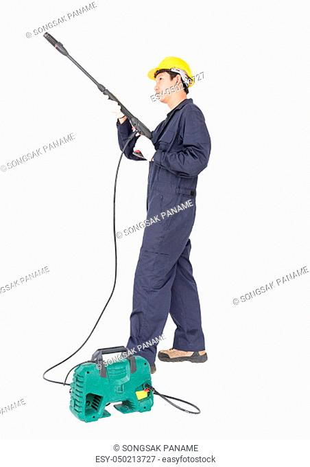 Young man in uniform stand and holding high pressure water gun portable with hose, Cut out isolated on white background