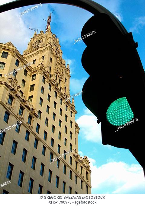 Telefónica building and traffic light, Gran Vía Street, Madrid, Spain
