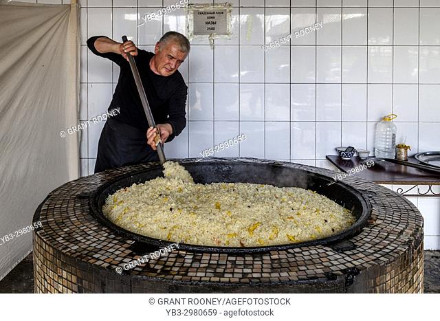 A Man Cooks Rice For PLOV (The National Dish) At The Central Asian Plov Centre, Tashkent, Uzbekistan