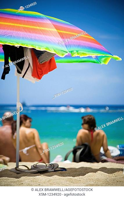 Colorful beach scene with parasol