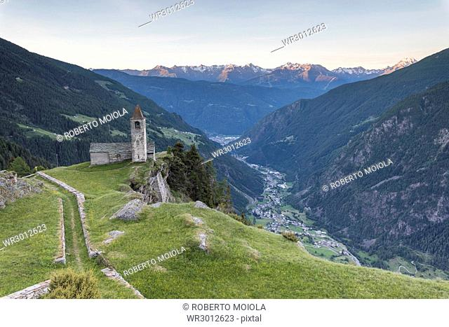 Ancient church at sunrise, San Romerio Alp, Brusio, Canton of Graubunden, Poschiavo Valley, Switzerland, Europe