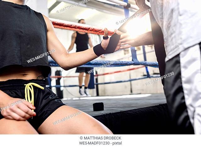 Female boxer getting prepared