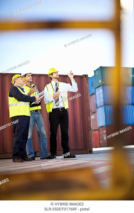 Workers talking in shipping yard