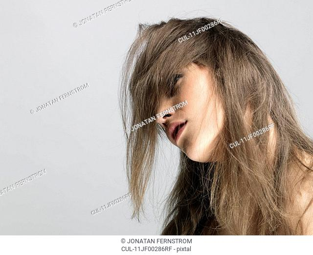 Young woman shaking her head