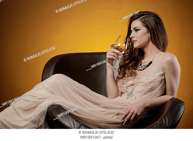 Young Woman drinking glass of wine