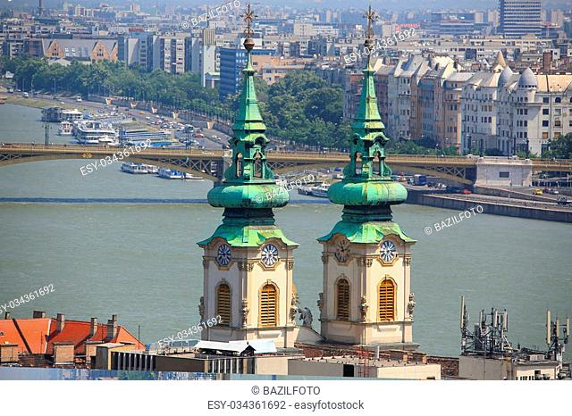 Traditional church towers and tourist Danube river, Budapest, Hungary