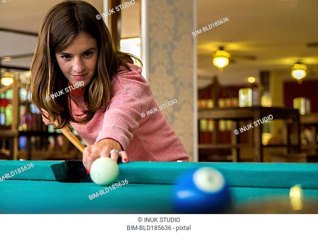 Caucasian woman playing pool