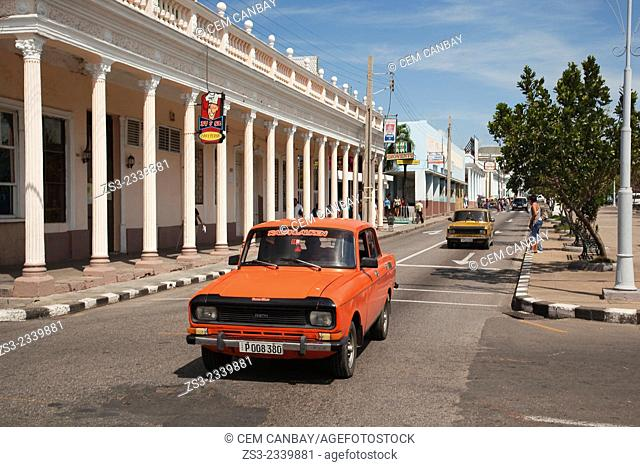 Old cars in the main avenue Prado at town center, Cienfuegos, Cienfuegos Province, Cuba, West Indies, Central America