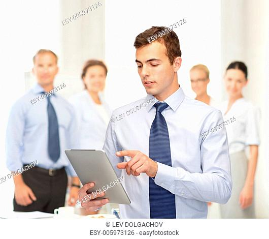 business, communication, modern technology and office concept - buisnessman with tablet pc