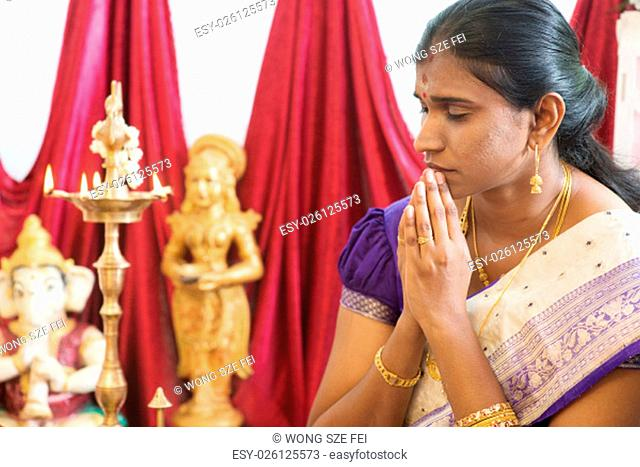 Woman hand folded during praying events. Traditional Indian Hindus ear piercing ceremony. India special rituals
