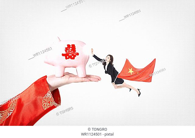 a business woman with a flag of chine holding a piggy bank