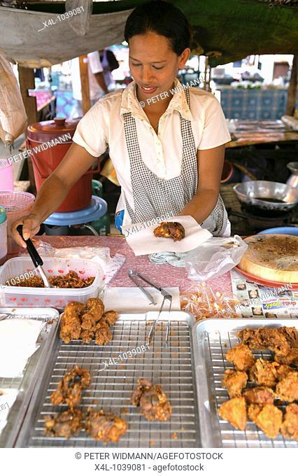woman sales thai food on market in Thailand