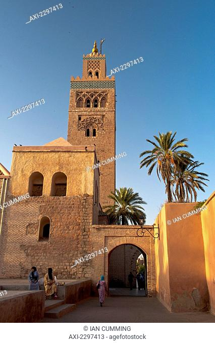 People beside Koutoubia Mosque at dawn; Marrakesh, Morocco