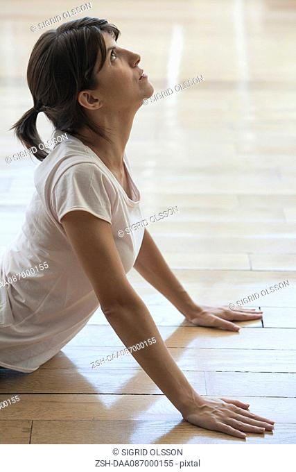 Woman stretching in cobra pose