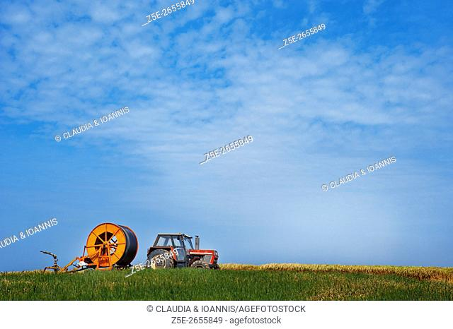 Tractor with irrigation system on a field in Thessaly, Greece