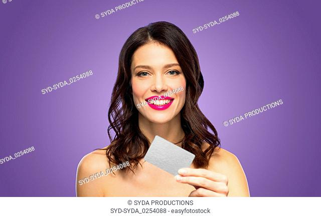 beautiful woman with pink lipstick and credit card