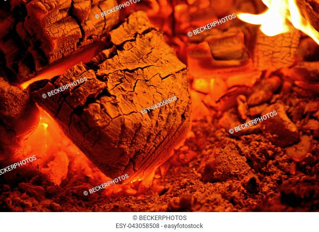 red hot coals glowing inside a wood stove