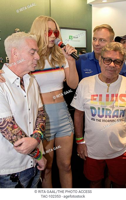 Elvis Duran (l) and Iggy Azalea (c) participate in Miami Beach Gay Pride Parade on April 10, 2016 in Miami Beach, Florida
