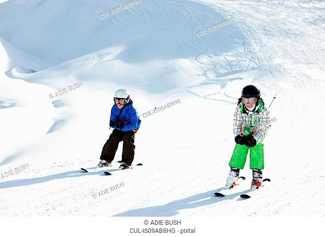Brother and sister skiing, Les Arcs, Haute-Savoie, France