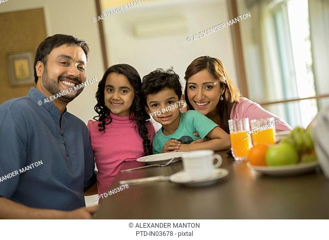Family of four at dining table