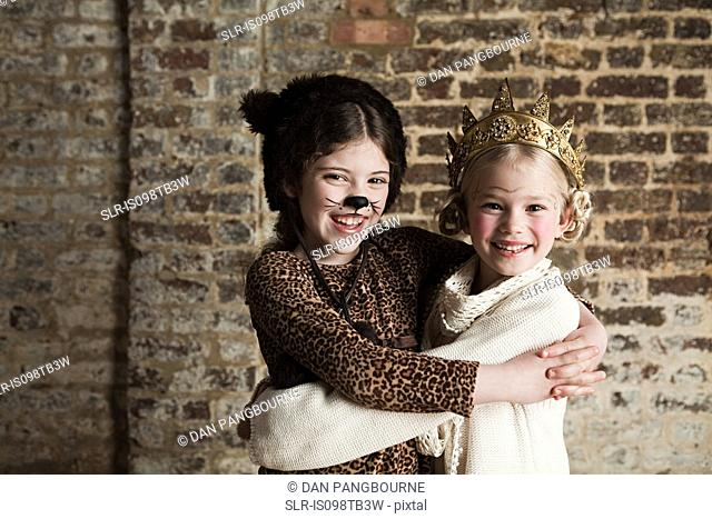 Young girls dressed up as cat and queen
