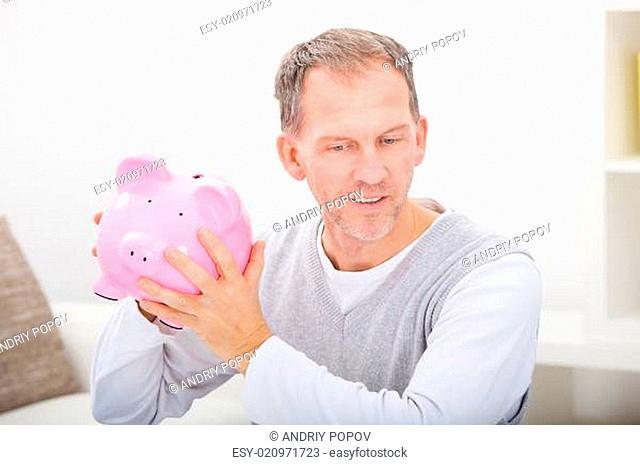 Man Holding Piggybank