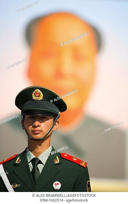 Soldier in front of the huge portrait of Chairman Mao in Tianenmen Square, Beijing