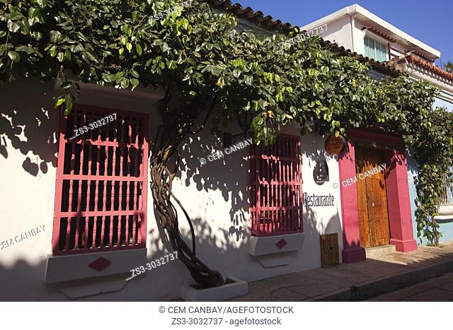 View to the colorful colonial building used as a restaurant at the historic center, Cartagena de Indias, Bolivar, Colombia, South America