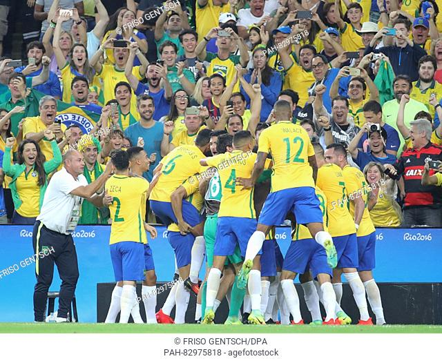 Neymar (hidden) of Brazil celebrates after scoring the opening goal 1-0 during the Men's soccer Gold Medal Match between Brazil and Germany during the Rio 2016...