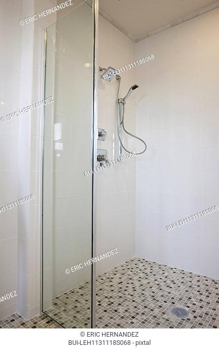 Contemporary bathroom with glass shower at home; Irvine; California; USA
