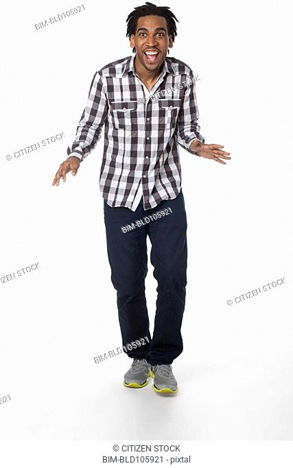 Smiling African American man with arms outstretched
