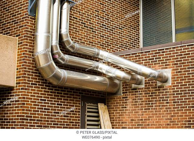 Metal pipes attached to the outside of a building