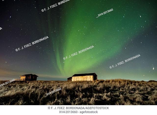 Warehouse with Aurora Borealis background, Northern lights in winter. Southern Iceland