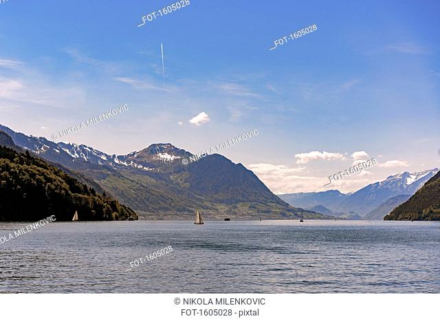Scenic view of Lake Lucerne and mountains against sky, Brunnen, Switzerland