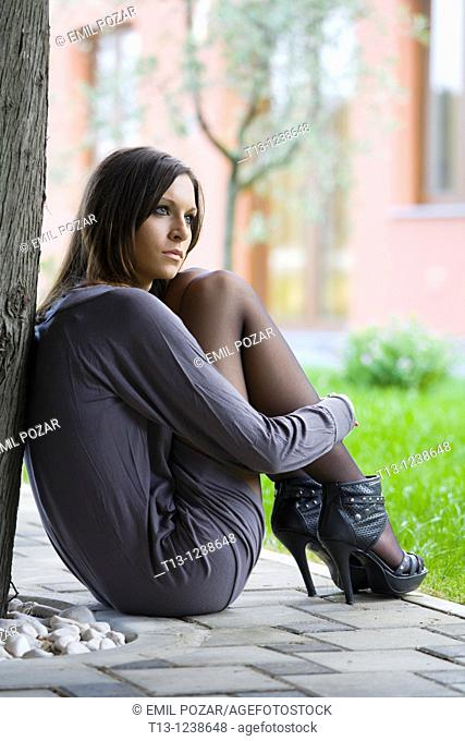 Daydreaming sexy young woman
