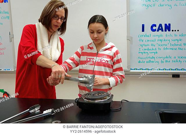 Teacher and Student Studying Chemical Reaction to Heat, Wellsville, New York, USA