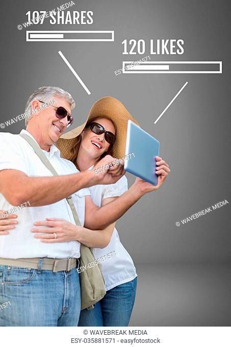 Couple on tablet with shares and likes on Social media interfaces