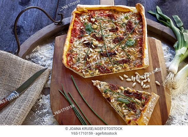 Pizza topped with cottage cheese and herbs