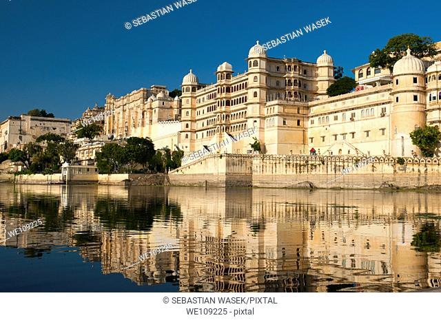 View from Lake Pichola on City Palace complex, It was built by the Maharana Udai Mirza Singh as the capital of the Sisodia Rajput clan in 1559