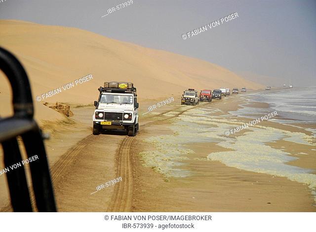 Jeeps at the Atlantic Ocean near Langewand, Diamond Area, Namibia