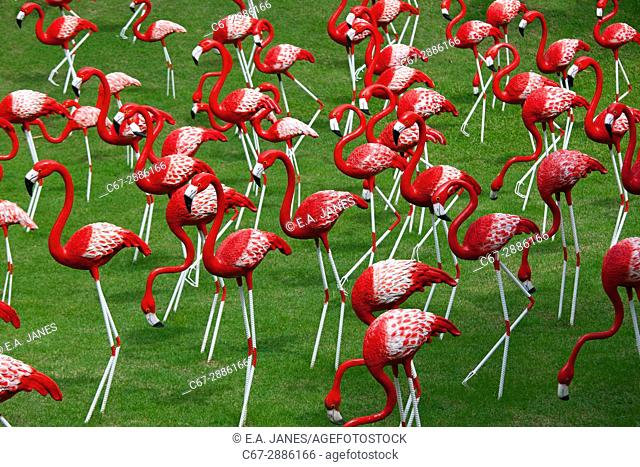 Model flamingos on the lawn of wildlife park in Thailand